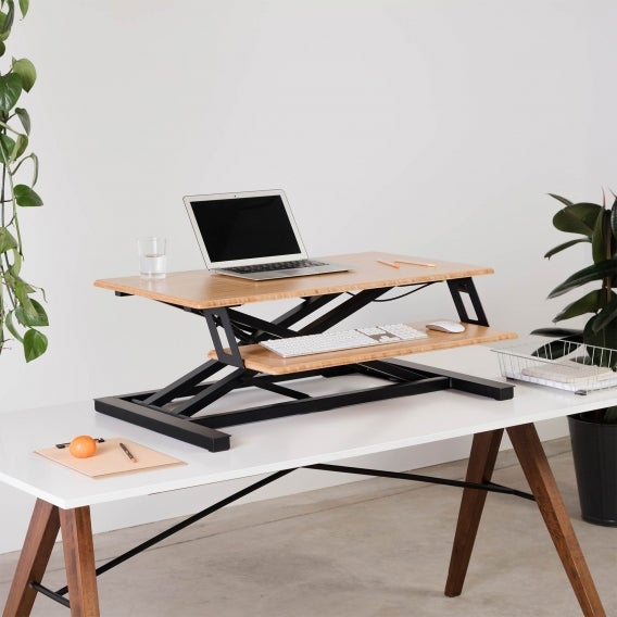 fully cooper standing desk converter bamboo extended with laptop