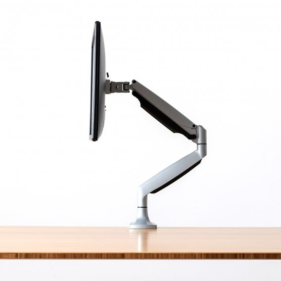 fully jarvis monitor arm mounted to jarvis desk with monitor silver side view