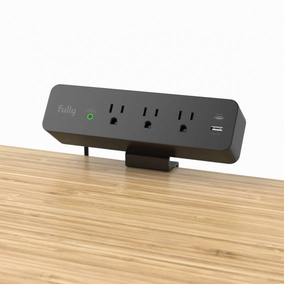 fully clamp mounted surge protector on jarvis desk black