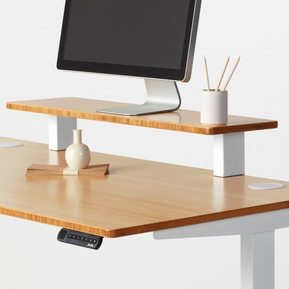Computer monitor on a Jarvis desk shelf in bamboo with white supports