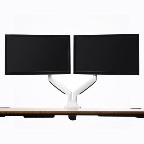 fully jarvis dual monitor arm mounted to jarvis desk with monitors silver