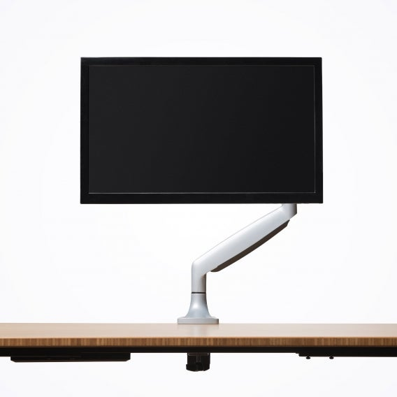 fully jarvis monitor arm mounted to jarvis desk with monitor silver front view