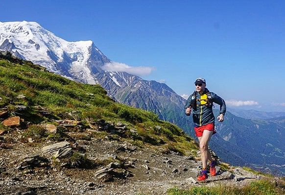 """Runner in Alpines. Link to """"How one runner hacked his desk job to train for 109 miles of alpine running"""" article."""