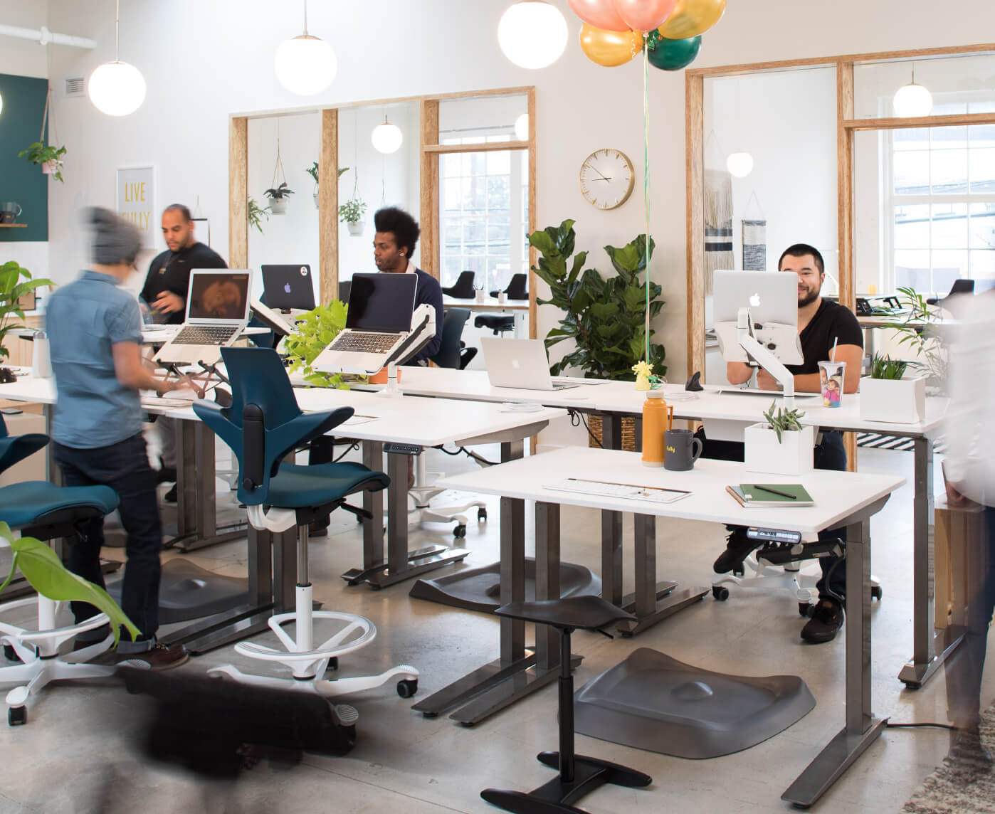 Fully office with Jarvis standing desks, Capisco Puls chairs, Tic Toc chairs, and Topo mats