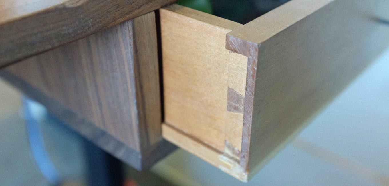 A close up of the wood drawer on a Jarvis Standing desk
