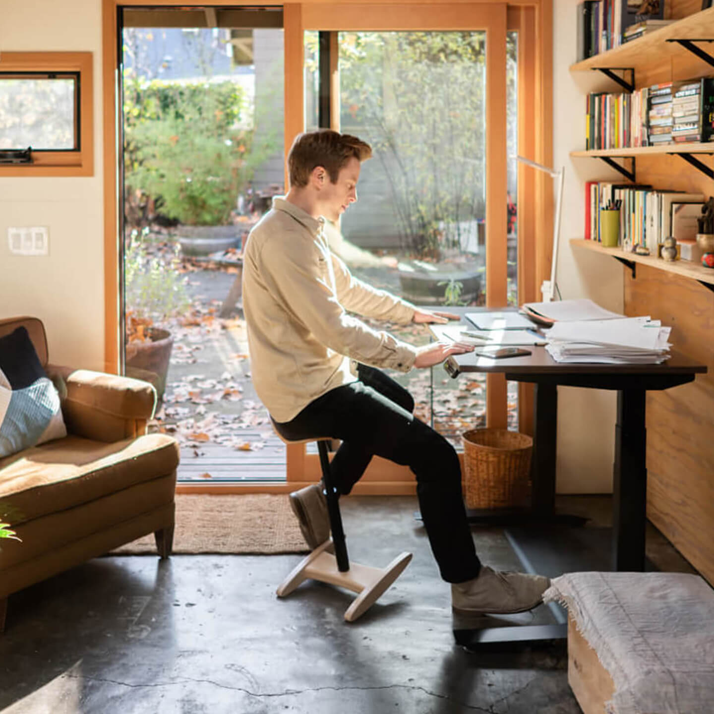 home office person sitting on a tic toc at their jarvis standing desk