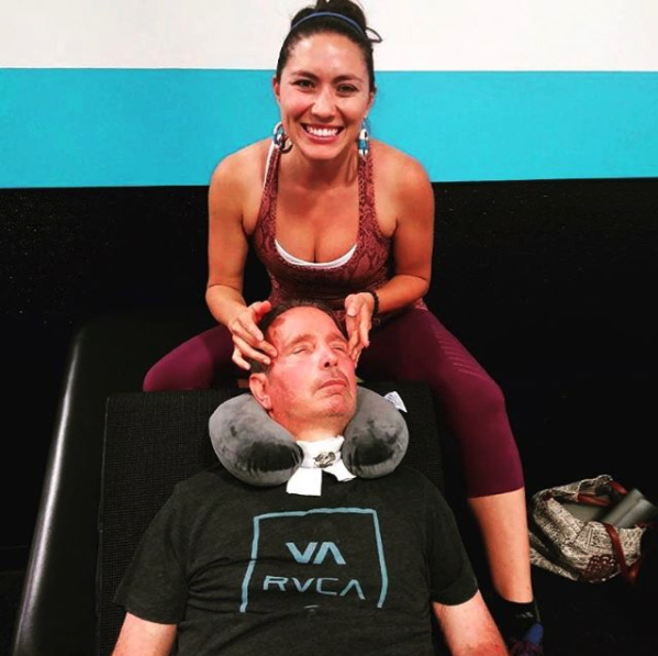 Jacqueline Toomey practicing sleep therapy on a man