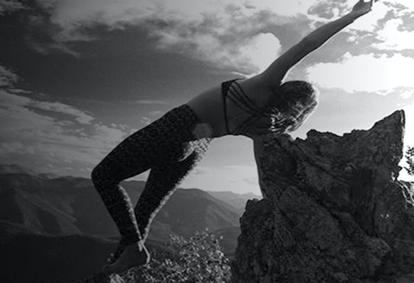 Jacqueline Toomey practicing yoga on top of a mountain