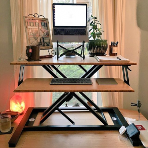 Jarvis Cooper standing desk converter in a living room with a laptop