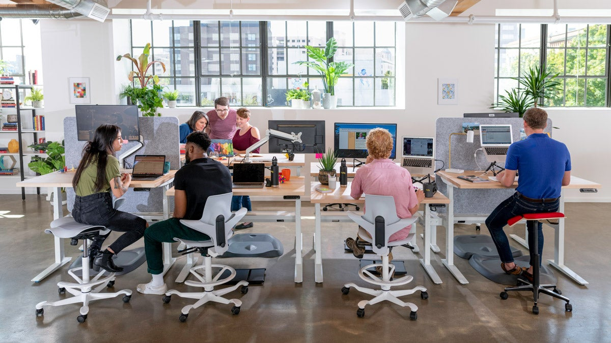 Team Fully at Jarvis standing desks with Capisco Puls chairs and Iloa stools