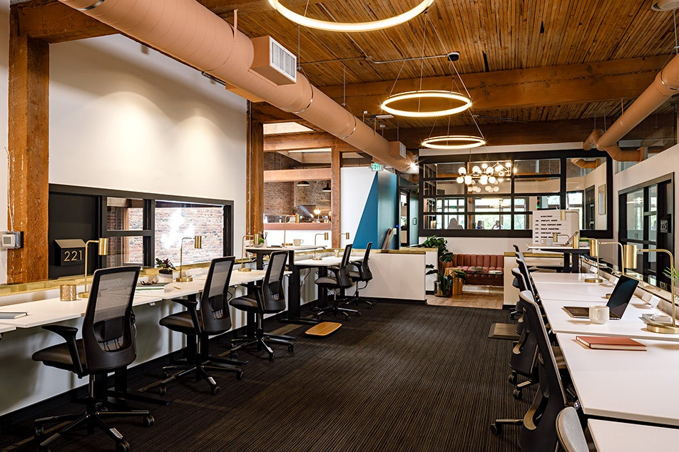 Fully desks and chairs in coworking environment