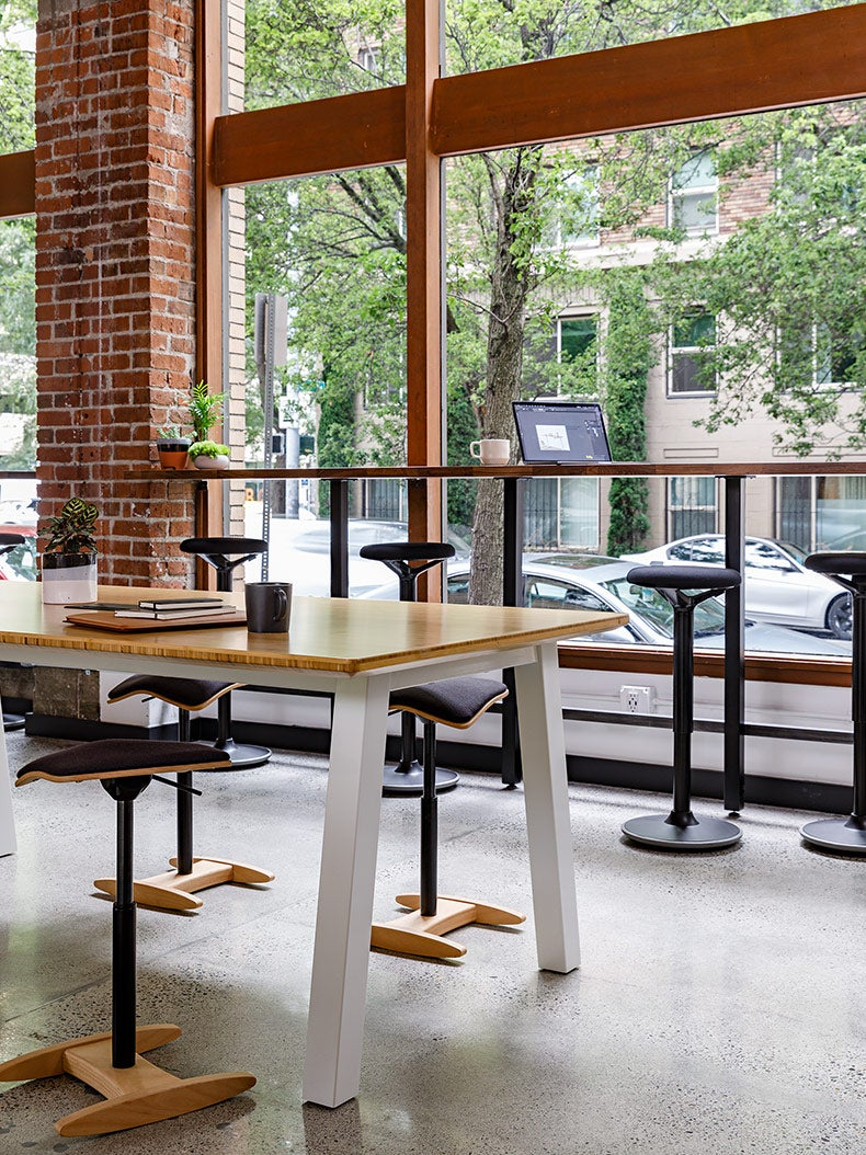 Fully Tic Toc and luna chairs and Colbe picnic tables in use at a coworking space
