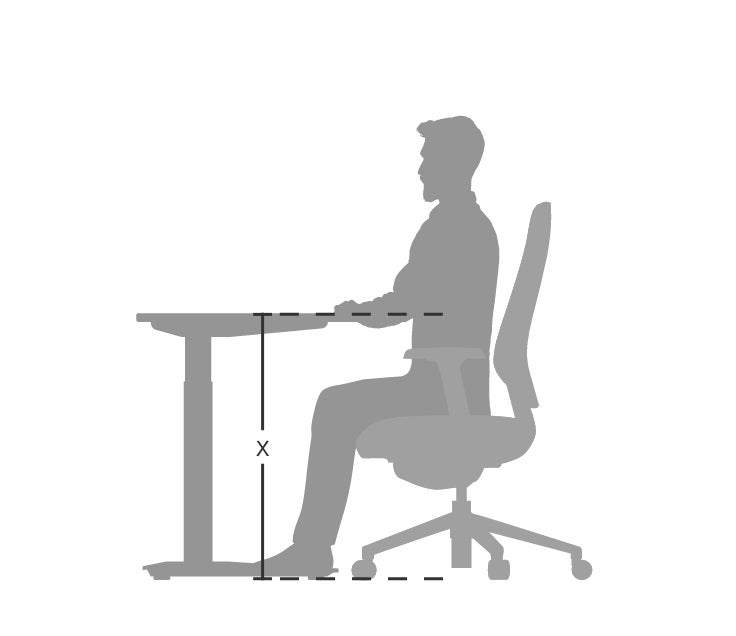 person seated at standing desk