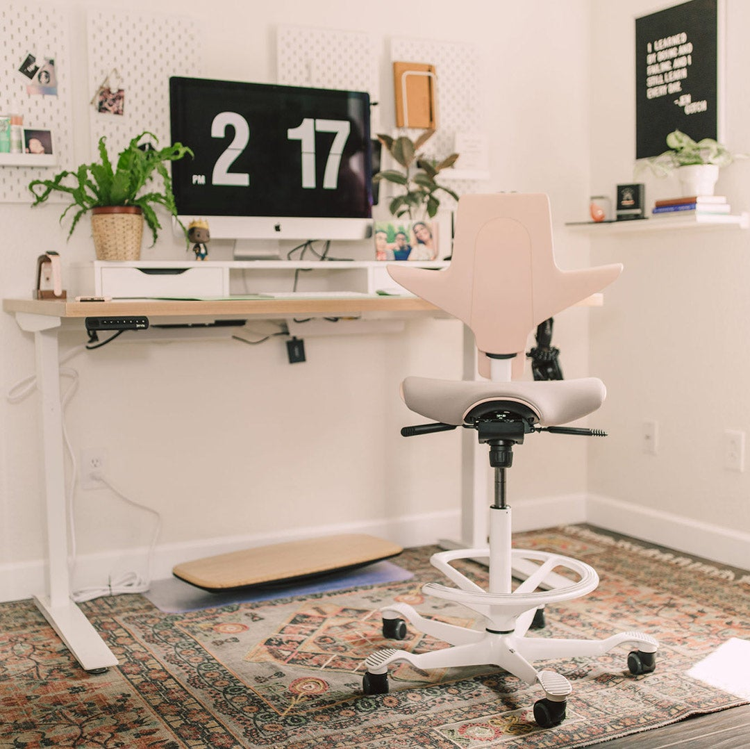 Capisco Puls Plus chair in Pink with Jarvis Hardwood Standing Desk and Floatdeck Balance Board
