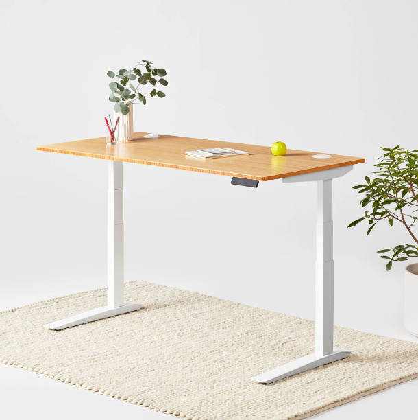 Jarvis bamboo standing desk with a white frame