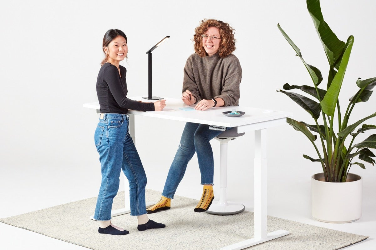 Remi standing desk with team fully