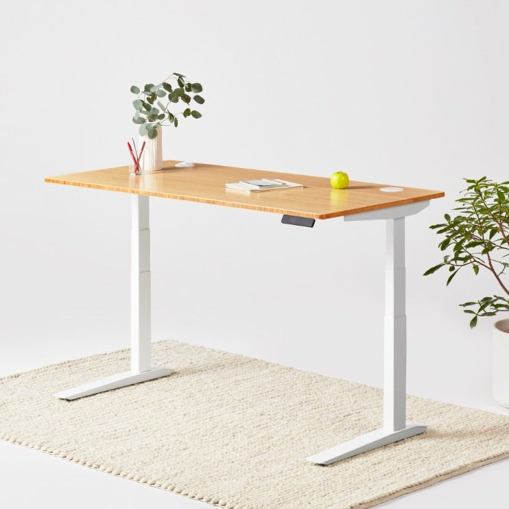 Fully Jarvis Bamboo Standing Desk in Natural Bamboo on a White Frame