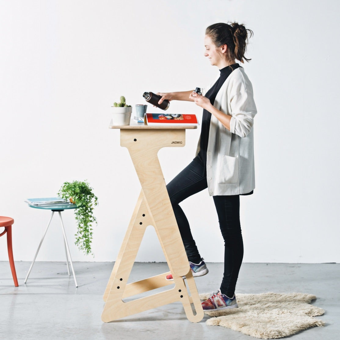 Jaswig standing desk in use by a woman working