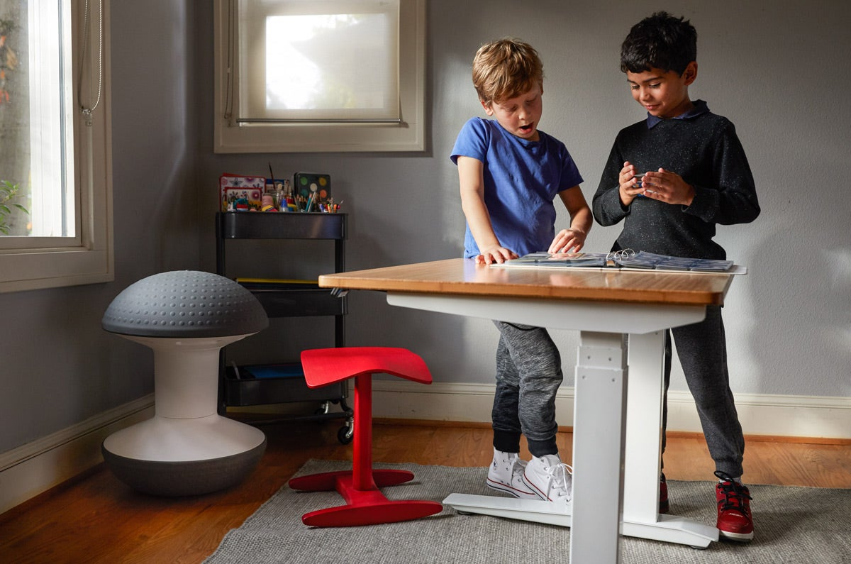 Kids work together on a Jarvis Kids standing desk