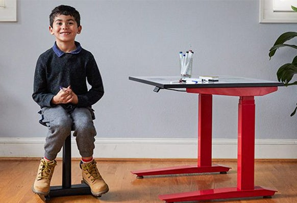 fully child on tic toc chair at Jarvis Kids standing desk