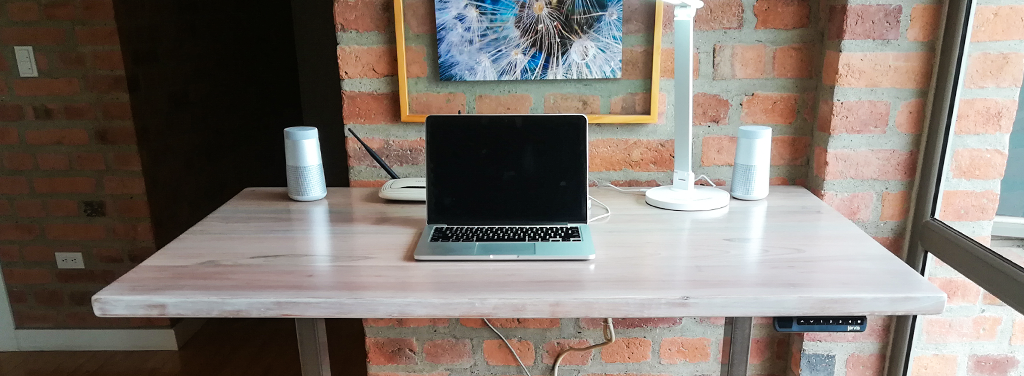Jarvis desktop with laptop and Beam LED lamp and wireless speakers