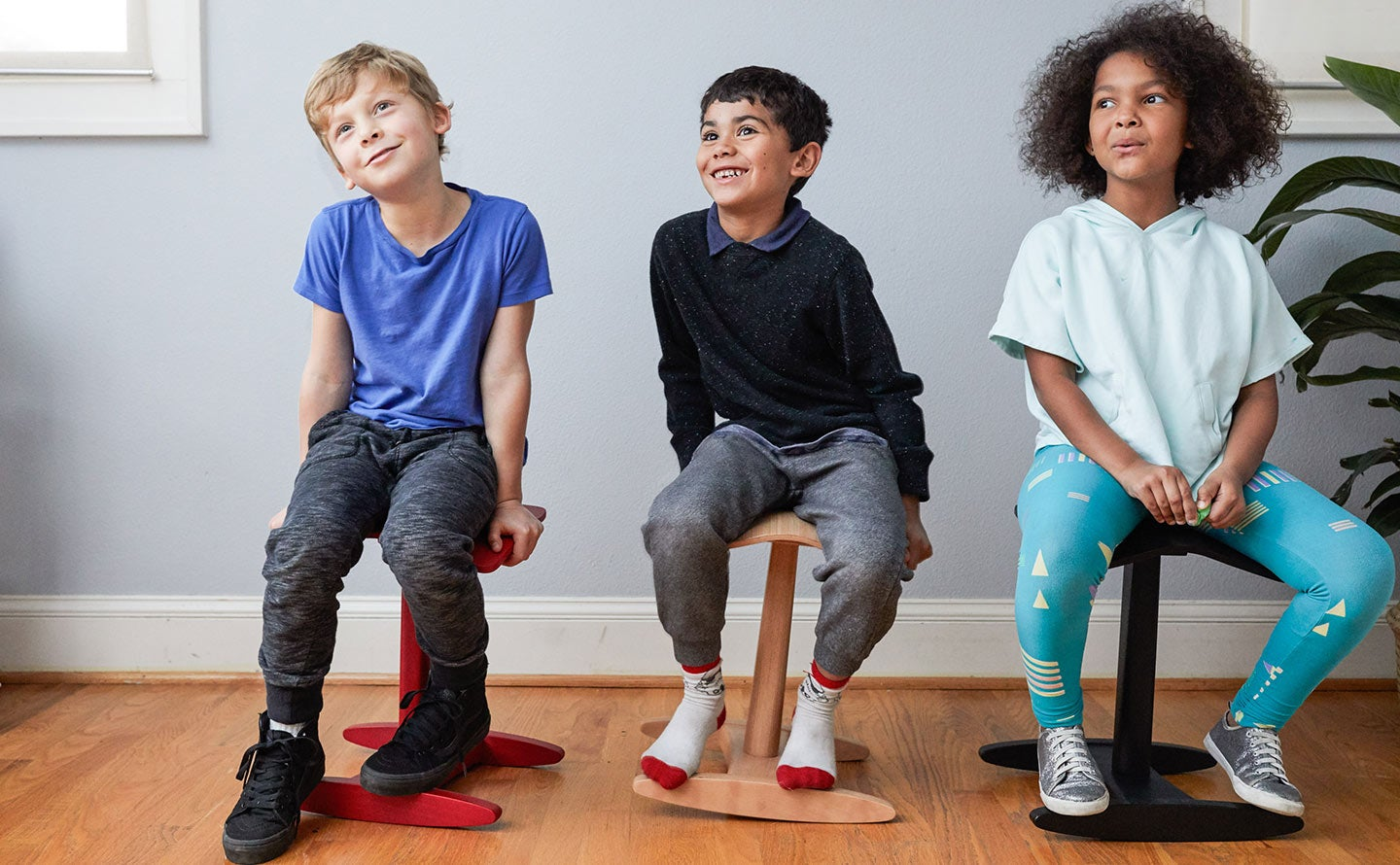 fully tic toc tyke black natural red stool in use by three kids