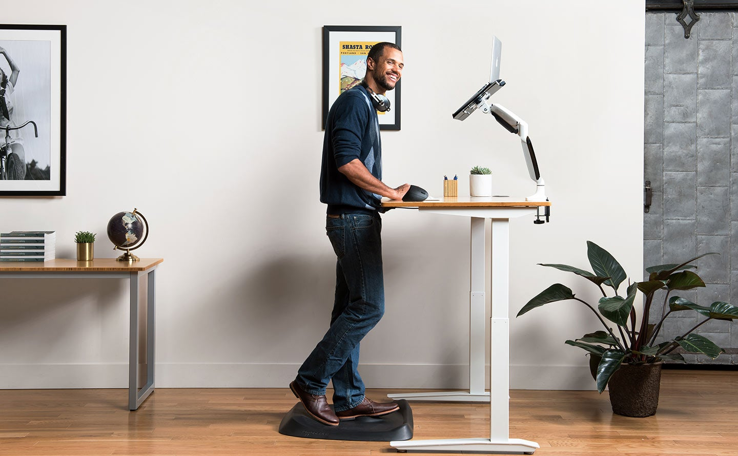 fully topo mini and topo anti fatigue mats topo mini in use by man with jarvis desk lifestyle photo