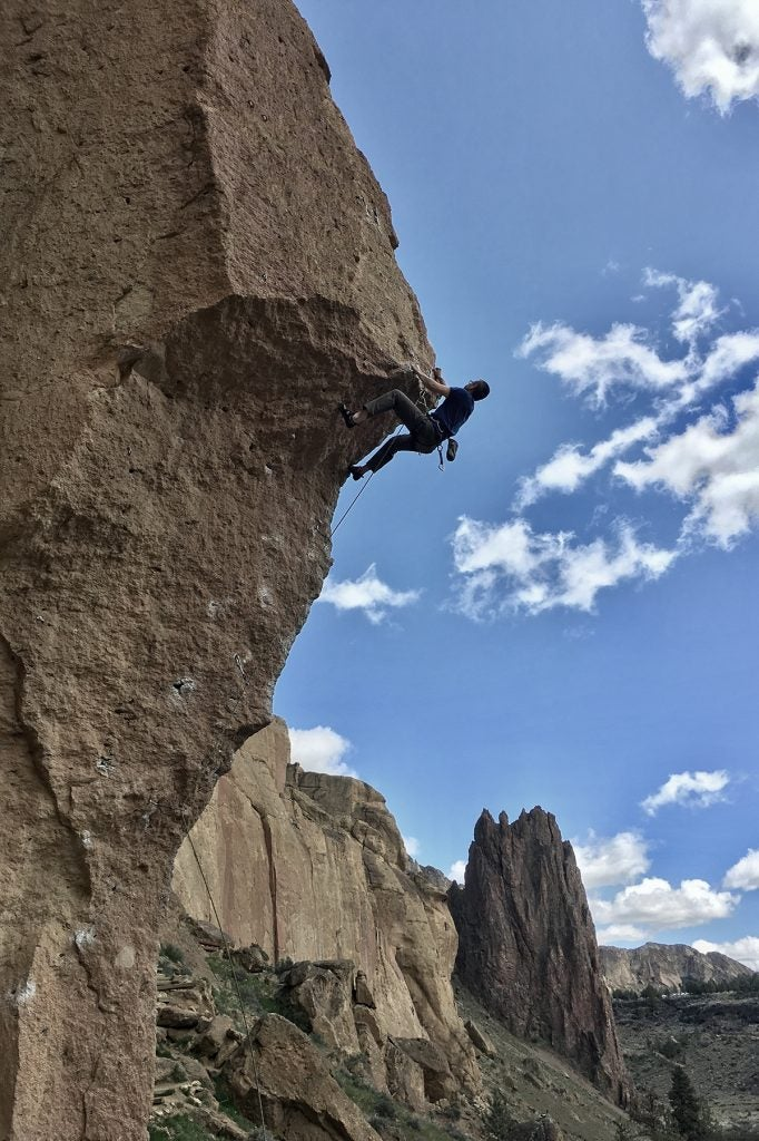 Jeremy Currie rock climbing on his hike