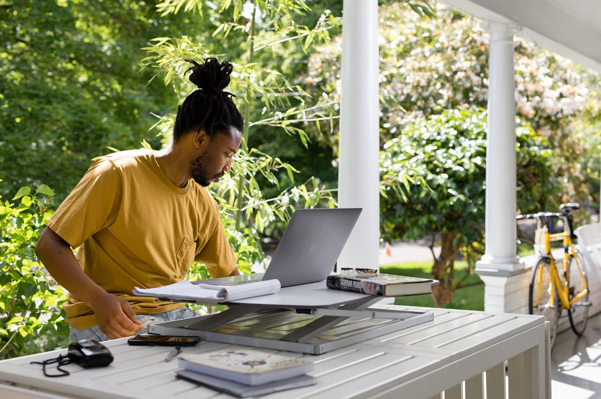 work from home image porch with cora converter and laptop