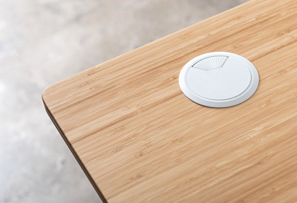 Fully Jarvis Wire Management Grommet on bamboo desktop