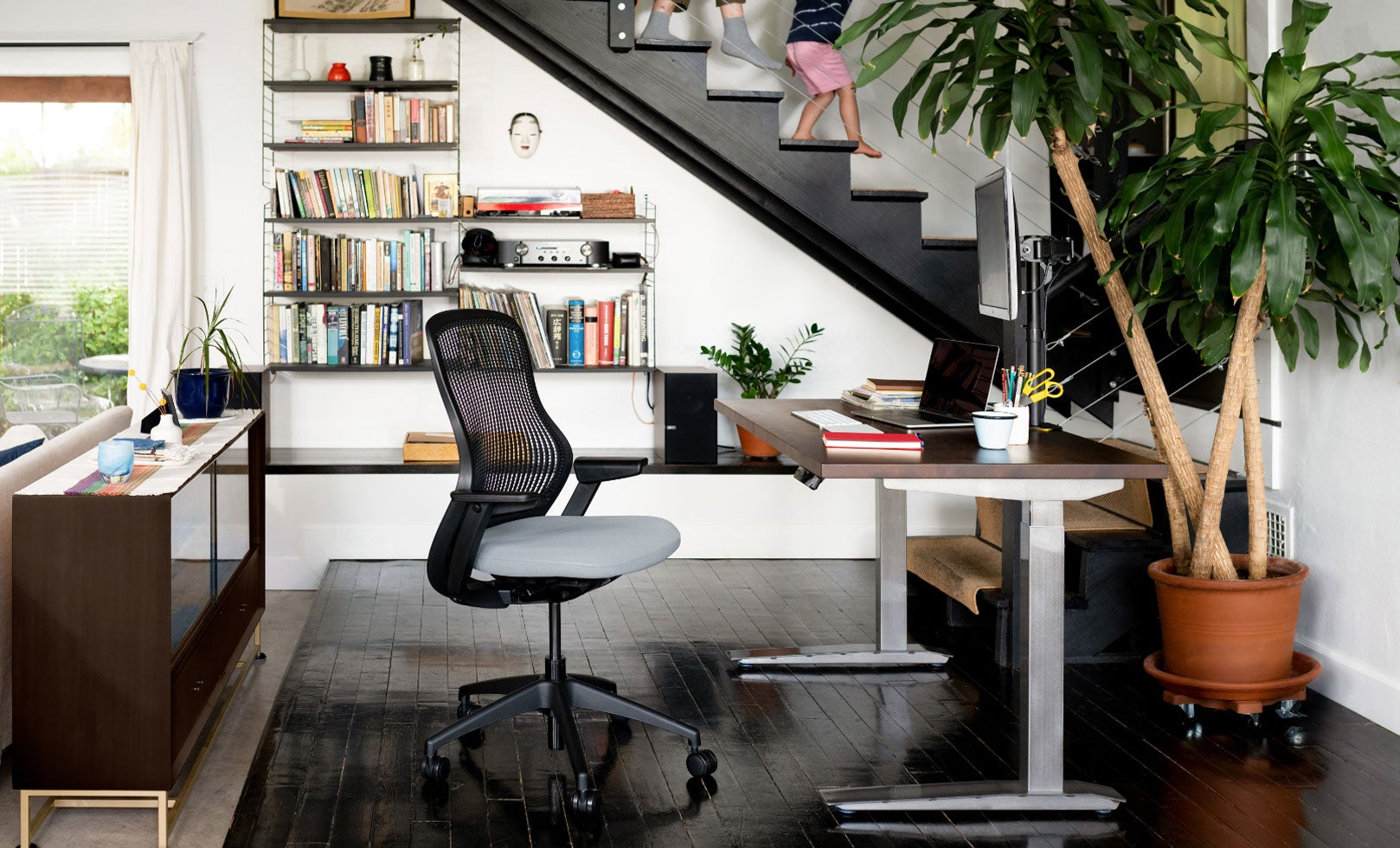 Fully Jarvis desk and Knoll ReGeneration chair in stairway home office with two people
