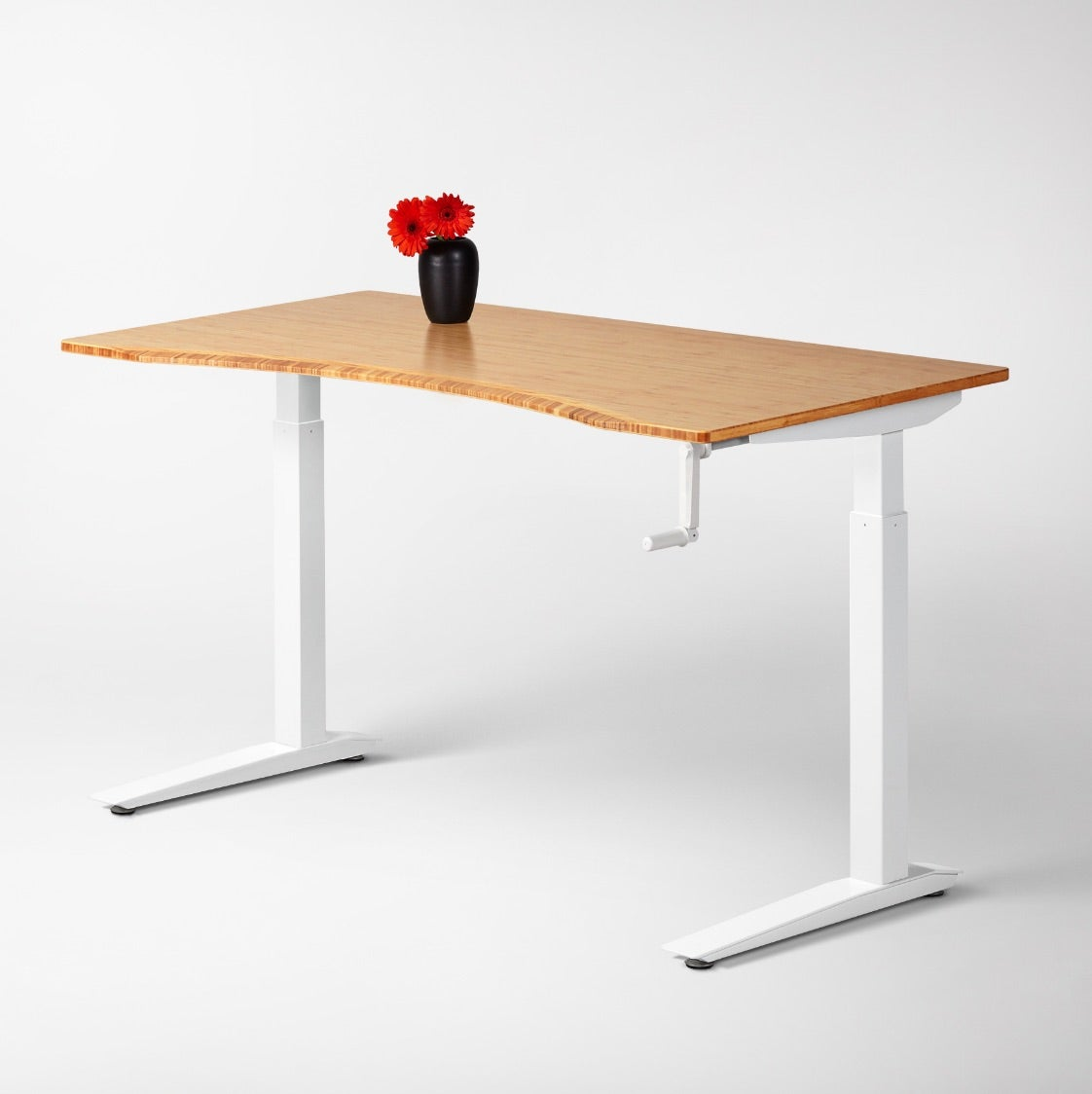 Jarvis Bamboo Crank-Powered Standing desk on a white frame