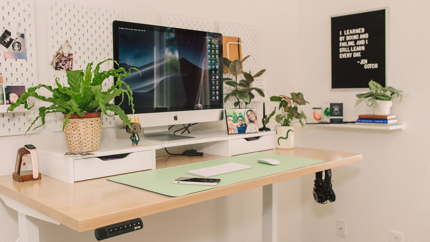 Jarvis hardwood standing desk with a monitor and working supplies